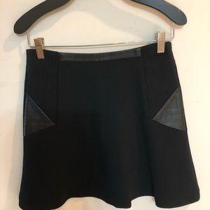 Sandro - Paris fabric and leather short skirt.